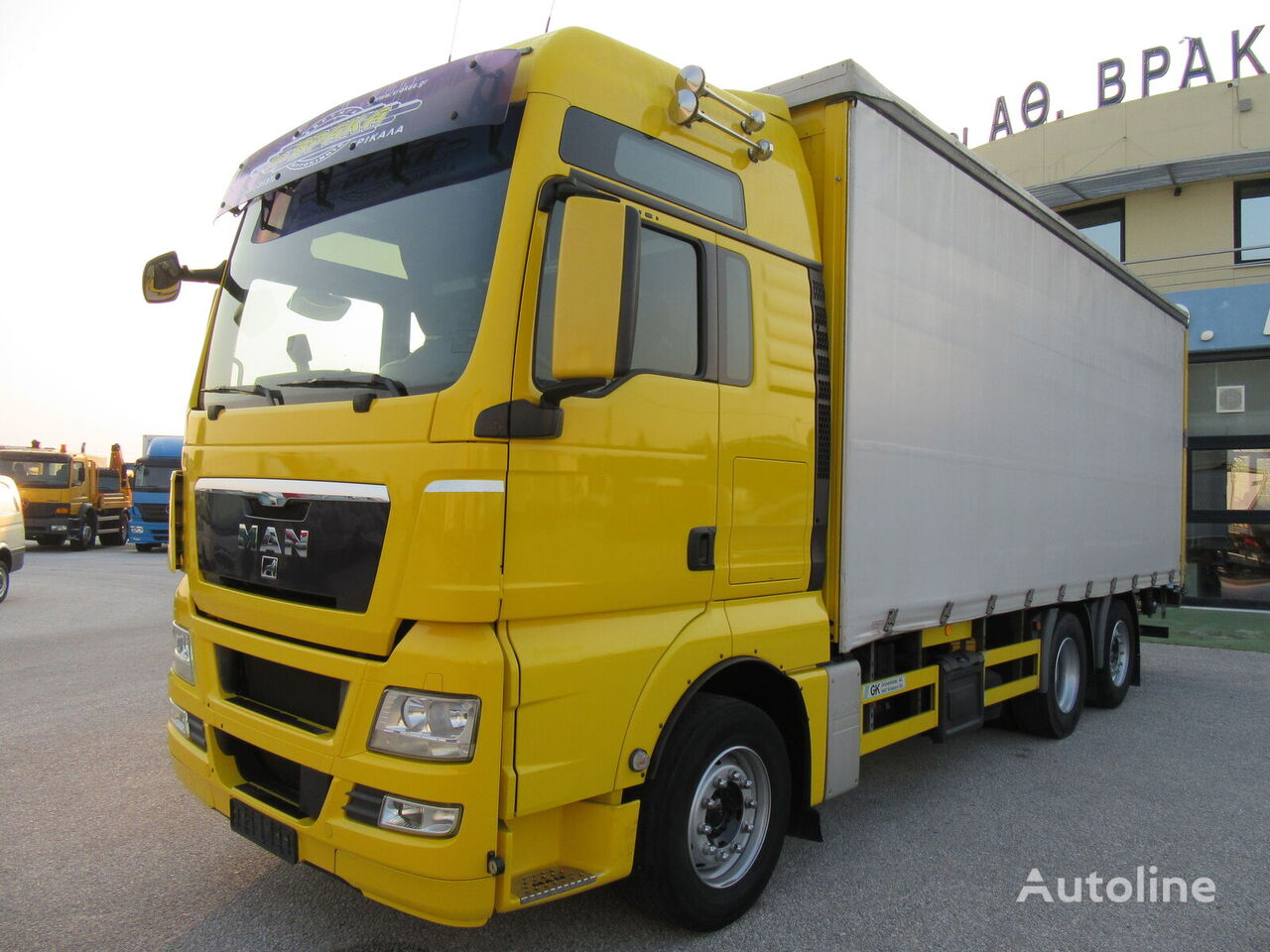 MAN 26440 TGX 6X2 /EURO 5 +RHYMOYLKO forteltet lastebil + gardintrailer